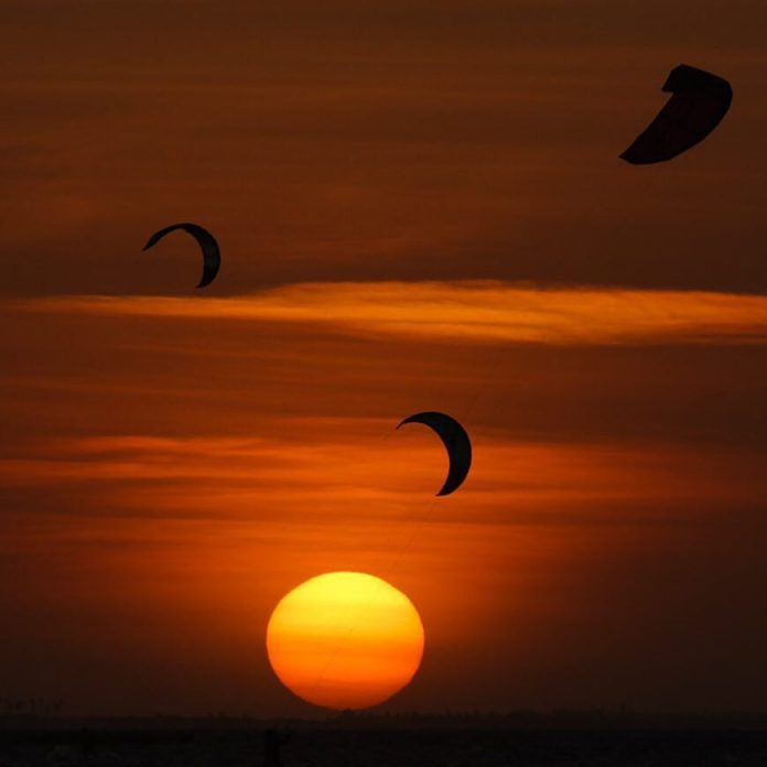 Kitesurf kiteboarding kitesurfing kiteboard women kitesurfer sport photo of the day image images photography kite surf leo-kitetrip-sunset